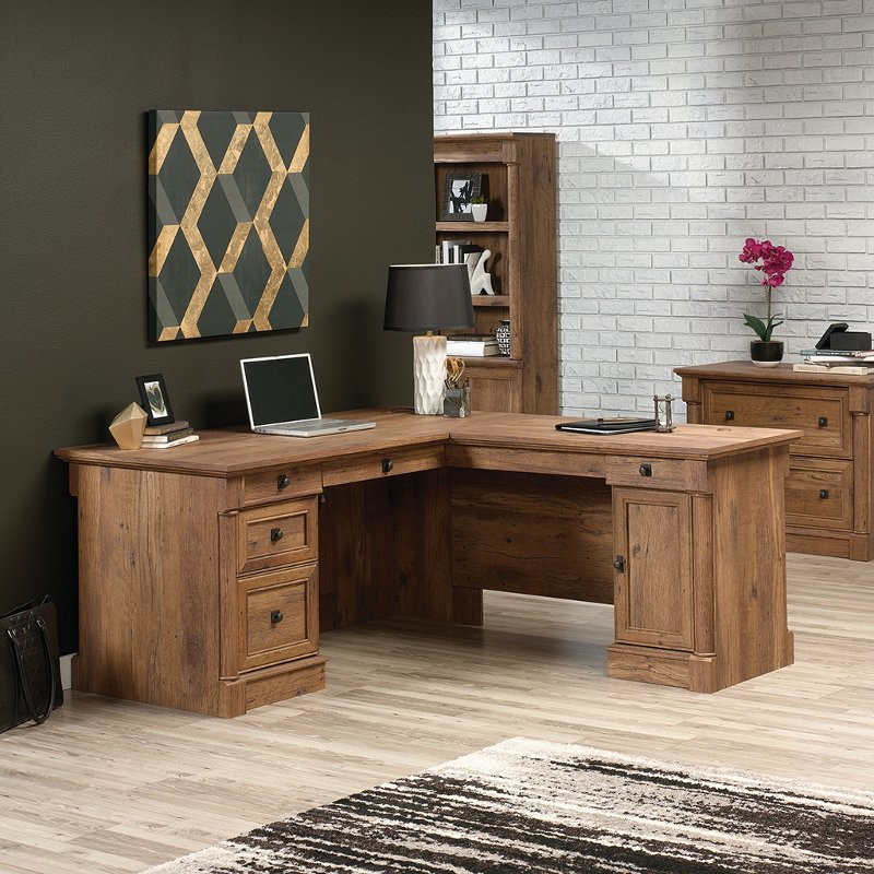 73a16132294 You will love this ready to assemble L shaped oak corner desk available  from RC Willey. This versatile piece of furniture is finished on all sides  allowing ...